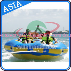 ประเทศจีน Sealed Towable 4 Person Inflatable Boats Yellow / Blue Rolling Donut Boat โรงงาน