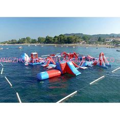 ประเทศจีน Red and Blue Inflatable Aqua Park , 0.9mm PVC Tarpaulin Inflatable Sports Park โรงงาน